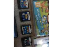 DS Nintendo (blue witch protective case) and 9 games