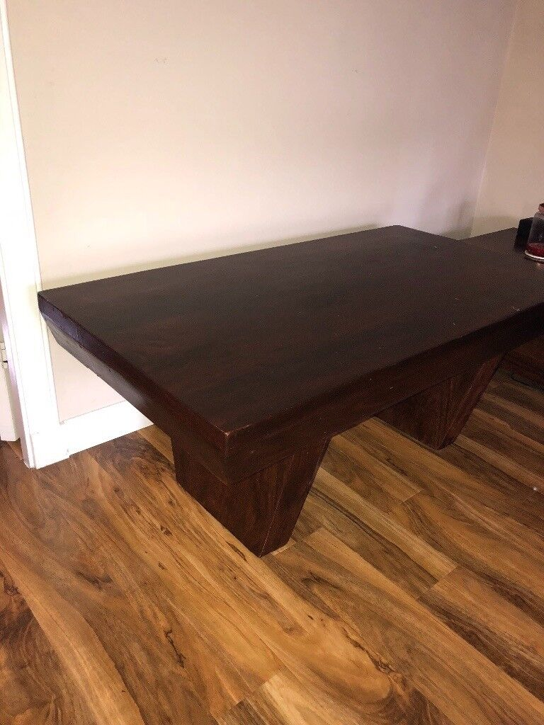 Dark wooden living/dining furniture