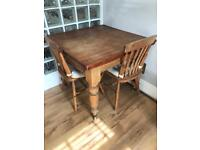 Victorian pine dining table with drawer and two pine chairs