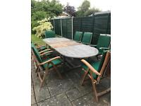Teak extending table + 8 reclining chairs + 8 seat covers in need of TLC