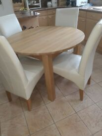 Leekes wood table and leather chairs