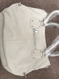 Cream Prada handbag