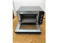 Mini oven . Silvercrest . Excellent condition . Great little appliance .Very little use .