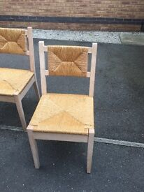 White table 90cm diameter four wicker chairs