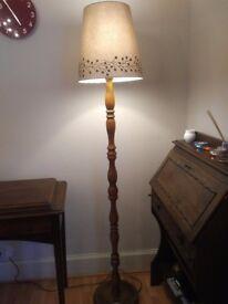 Dark wood standard lamp.