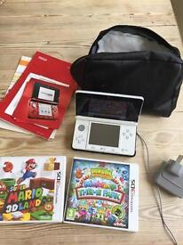 Nintendo 3DS in white with 2 games