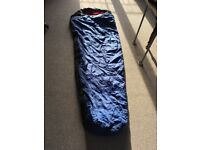 Eurohike 300 blue and black sleeping bag with red inner