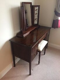 Mahogany dressing table with stool and mirror.