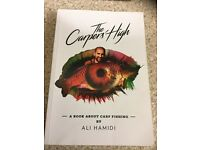 The Carpers High by Ali Hamidi. This is a book about Carp Fishing and takes you on a life's journey