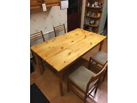 Wooden kitchen table with 4 chairs