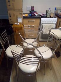 Glass Dinning Table and Chairs For Sale.