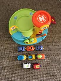 Early Learning Centre Garage, and 8 Whizz World Magnetic Cars