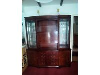 Large heavy Mahogany unit with drinks cabinet. Lighting operated by touching hindges