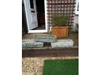 Three garden concrete troughs