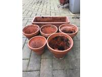 6 terracotta pots