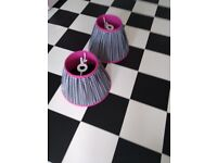 Two pink, black and white lampshades