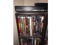DVD player with large selection of DVDs