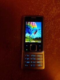 unlocked Nokia 6300, perfect condition with charger and battery, collection only