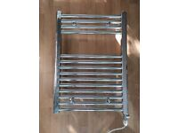 Duel fuel compatible towel radiator with electric heating element