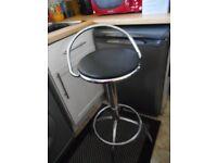 pair of chrome and black swivel seat bar stools