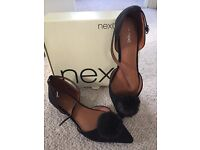 Women's shoes. Beautiful black Pom Pom flat shoes by next size 6.5 worn once for event