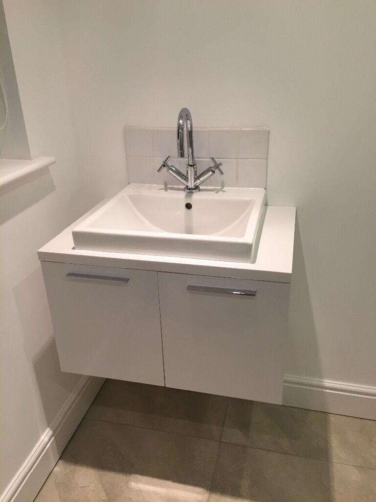 Bathroom sink and vanity unit