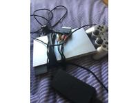 PlayStation 2 slimline silver with games
