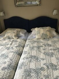 2 matching unused single beds, fire resistant with headboards, valances ,duvets in toile de jouey