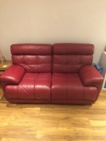 Red electric reclining leather sofa