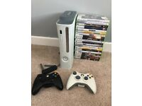 Xbox 360, 2 controllers, wireless adapter and 19 games