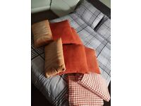 6 cushions with throws dunelm burnt orange