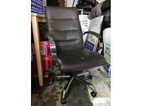 Dark brown leather swivel desk chair, chrome base and arms, used with some wear.