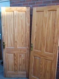 2 solid 4 panel interior doors