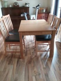 Pine extending dining table and 4 chairs in perfect condition.Buyer to collect.