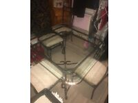 As new large glass rought iron dineing table and 4 chairs very heavy bargain £135 Ono