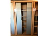 Side Opening Tambour Cupboard. 2200mm Height x 1100mm Width. Great Condition. 22 In Stock.