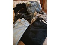 5 pairs of jeans and one pair black trousers