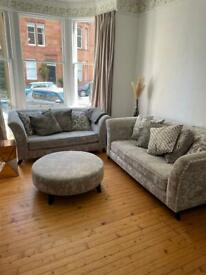 Silvery grey sofas and pouffe