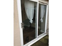 White UPVC double glazed patio doors in good condition 2/3 years old