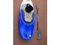 Pyranha kayak with carbon fiber paddle