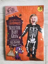 BRAND NEW WILKO HALLOWEEN SKELETON BABY GROW 6-12 MONTHS