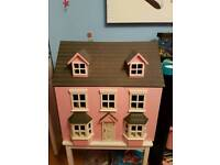 Wooden Dolls house with furniture.