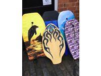4 Body Boards and a Skim Board in good condition