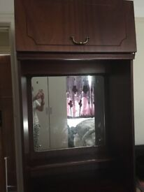 Cupboard with mirror and drawers and overhead storage