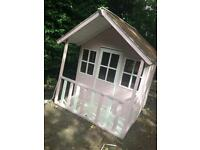 Pink and white children's Wendy house