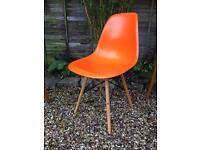 Eames style orange chair