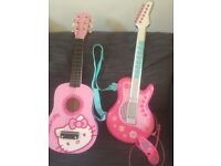 guitars for play - 1 battery operated and one Hello Kitty with strings. Pink.