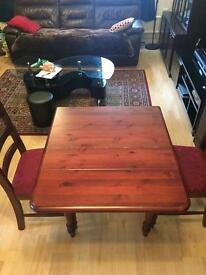 DINING TABLE AND TWO CHAIRS. EXTENDABLE