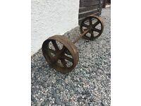 Vintage cast iron cart wheels.
