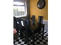Harvey's Noir Extendable Black Glass Table and 6 Chairs
